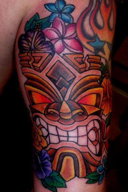 Coolest Hawaiian Tiki n Flowers Tattoo Design For Boys