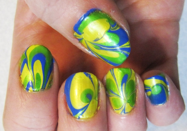 Cutest Flower And Leaves Design With Yellow And Blue Nails