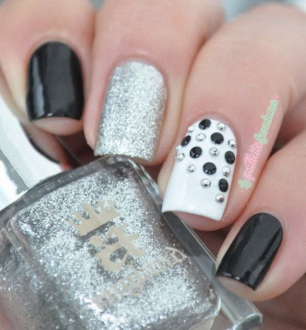 Dashing White And Black Nail Art With Silver One