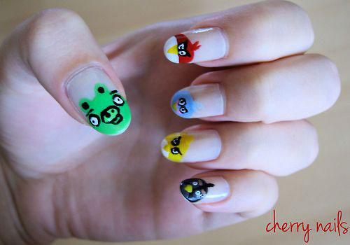 Eye Catching Pig With Stone And Angry Bird Nail Art Design