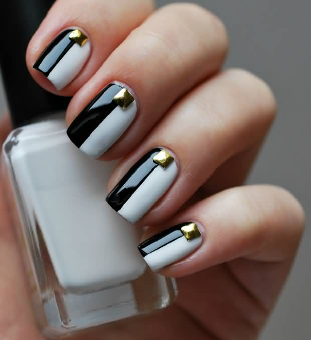 Eye Catching White And Black Nail Art And Golden Button
