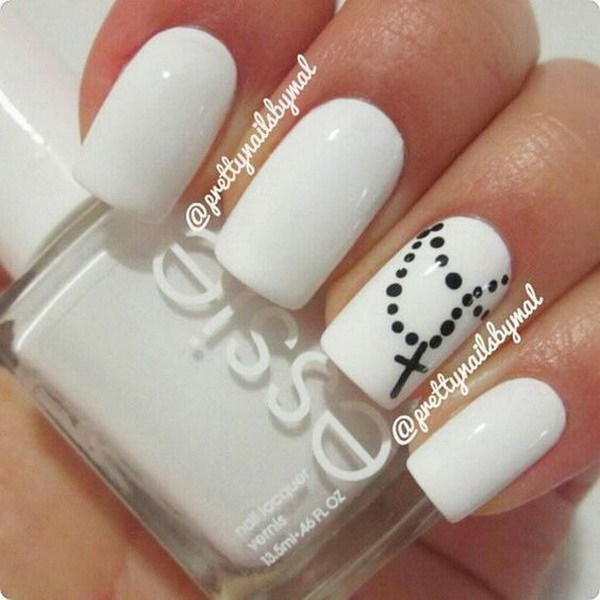 Eye Catching White And Black Nail Art With Cross Design