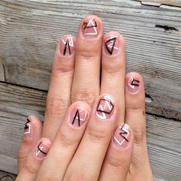 Eye Catching White And Black Nail Art With Triangle