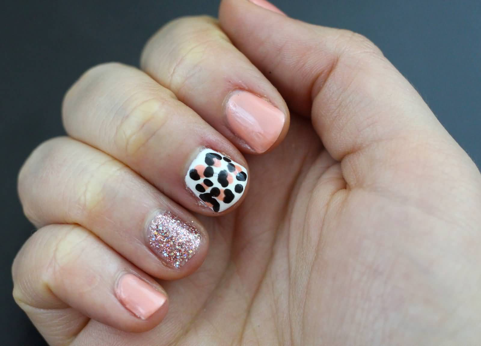 Fabulous Pink Nail Paint With Tiger Print Glitter Accent Nail Art