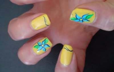 Fabulous Yellow And Blue Nails With Flower Design (2)