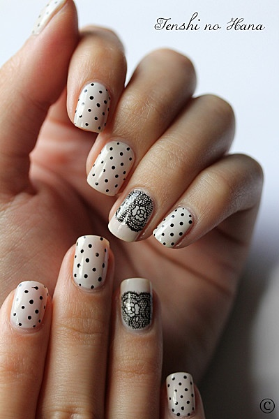 Fantastic White Nail Paint With Black dotted Accent Nail Art