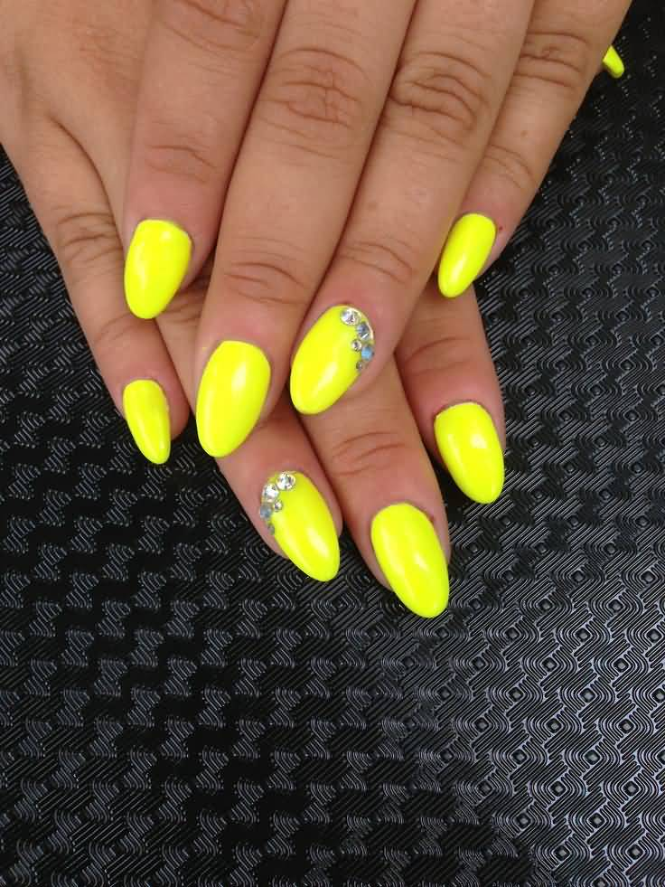 Fantastic Yellow And Blue Nails With Blue Color Crystal Design