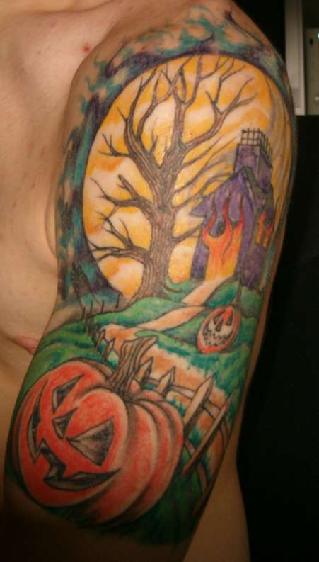Glowing Halloween Tattoo Design On Arm For Boys