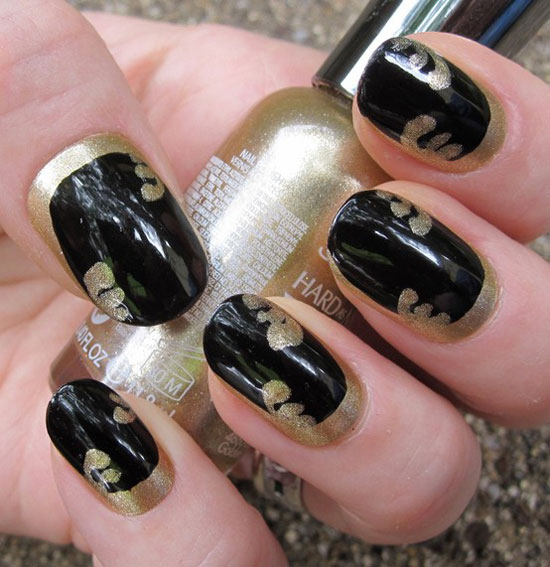 Great Black Nail Art With Golden Paint Design