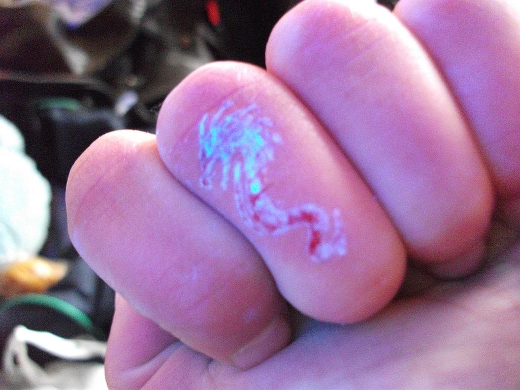 Great UV Dragon Tattoo On Finger For Girls