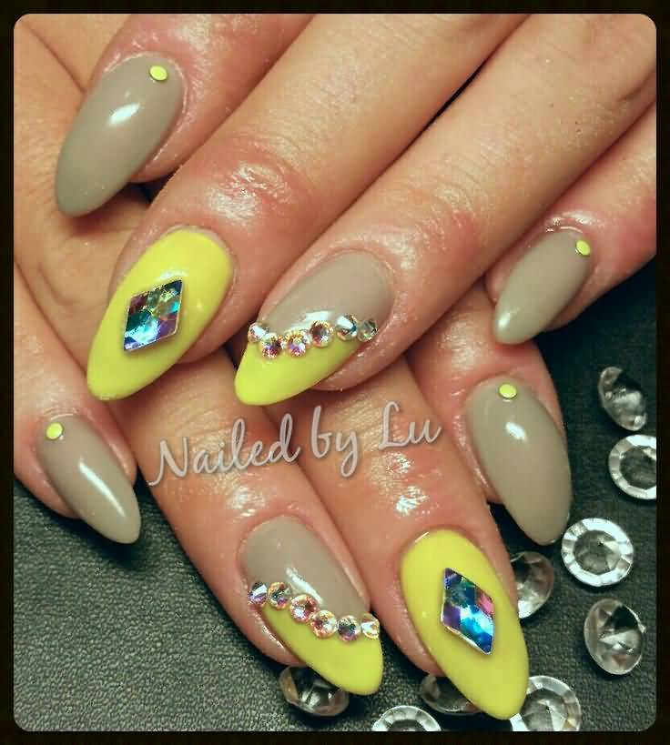 Great Yellow Color With Stones Almond Shaped Acrylic Nail Art