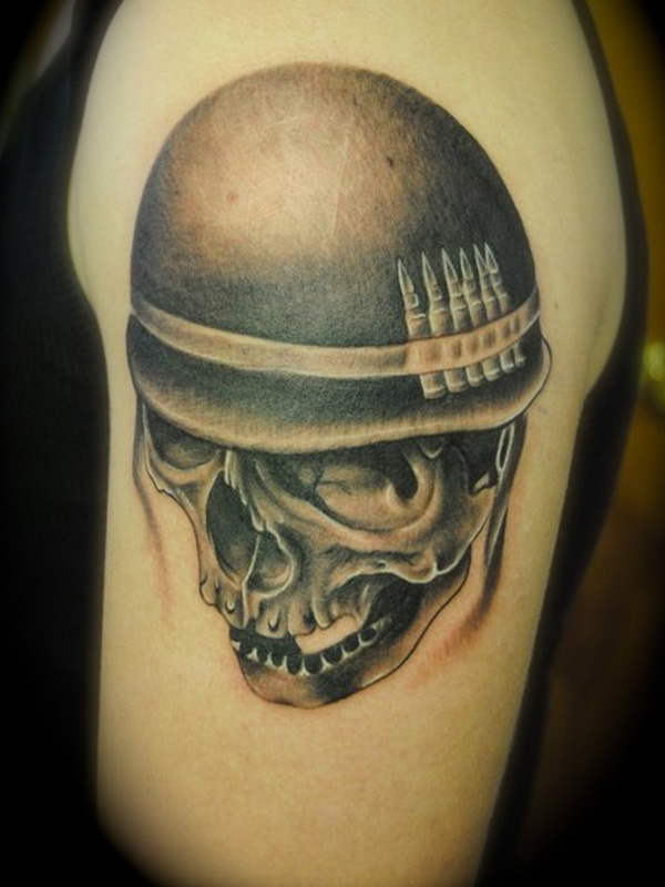Groovy Skull In Helmet Tattoo On Biceps For Boys