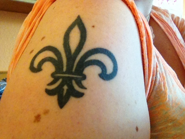 Horrible Fleur De Lis Tattoo On Shoulder For Girls