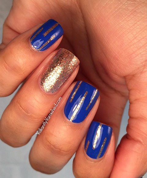 Incredible Blue And Golden Accent Nail Design