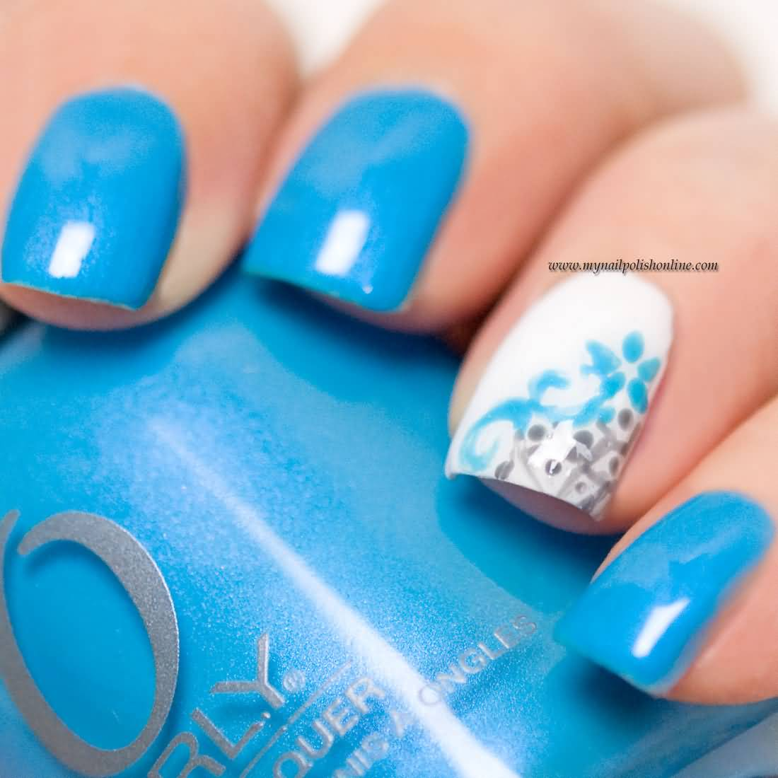 Incredible Sky Blue Nail Paint With Flower Accent Nail Art