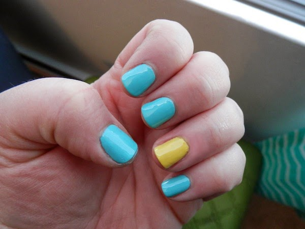 Incredible Yellow And Blue Nails With 1 Yellow Nail