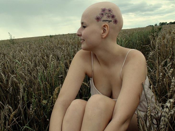 Lovely Flowers Head Tattoo For Women