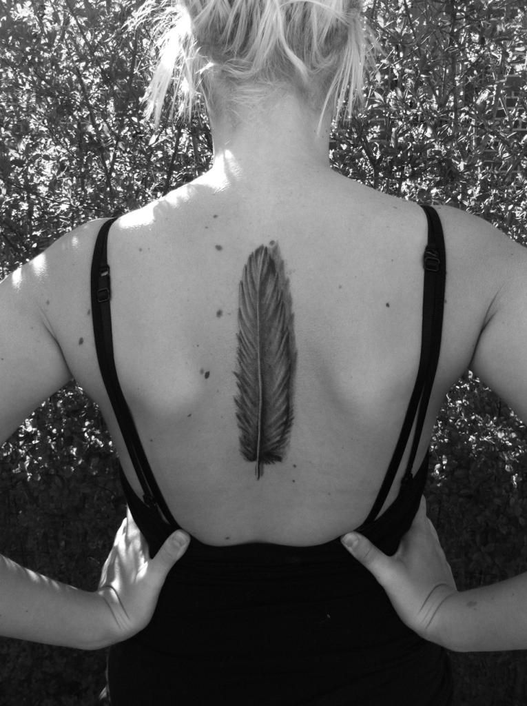 Marvel Feather Tattoo On Back For Women