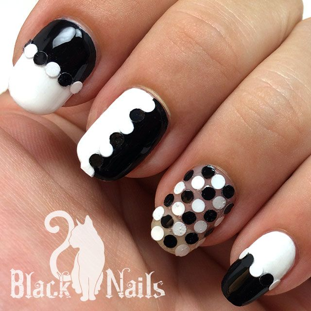 Most Unique White And Black Nail Art With Dotted Design