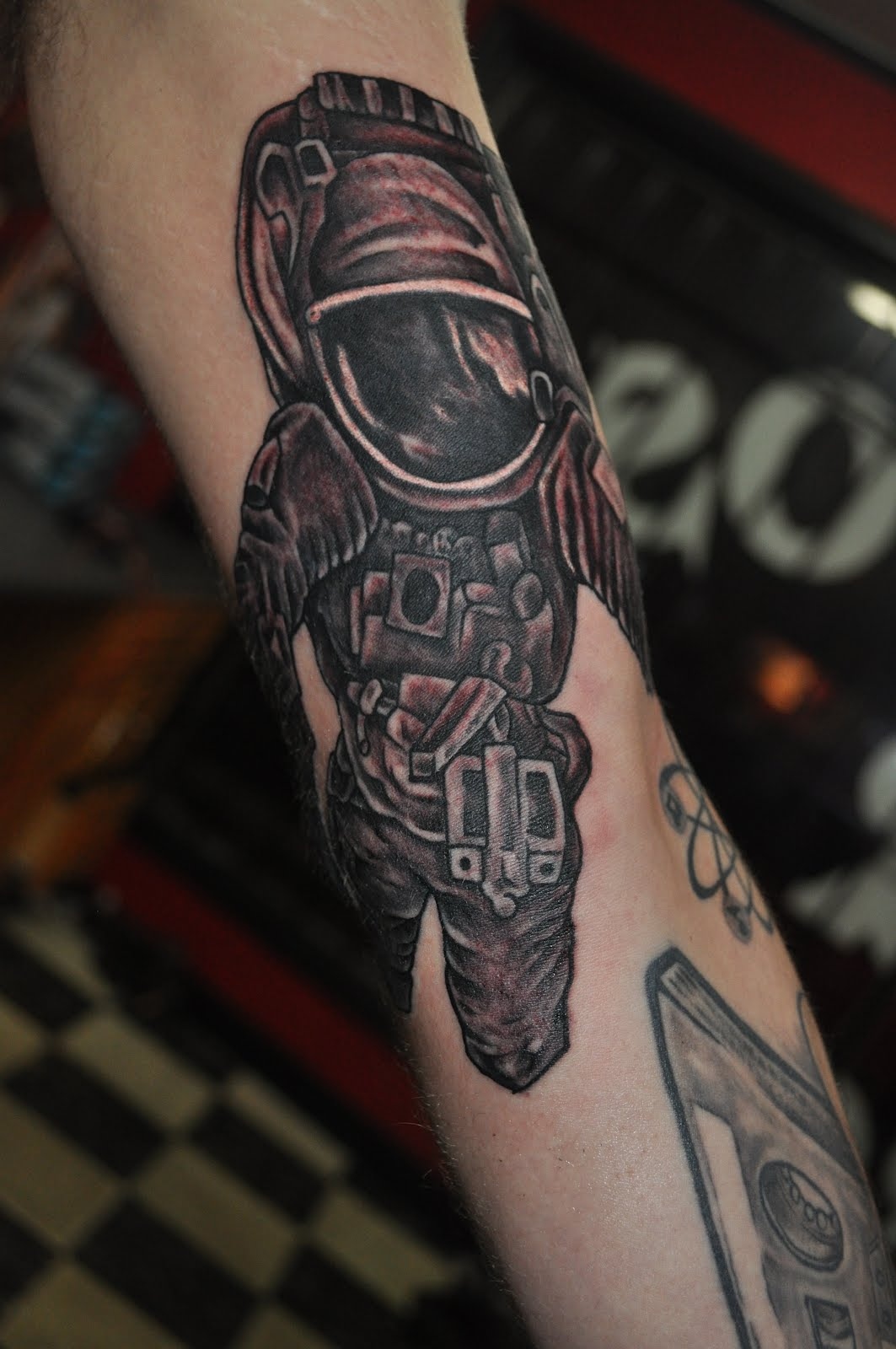 Motivational Spaceman Helmet Tattoo On Arm For Boys