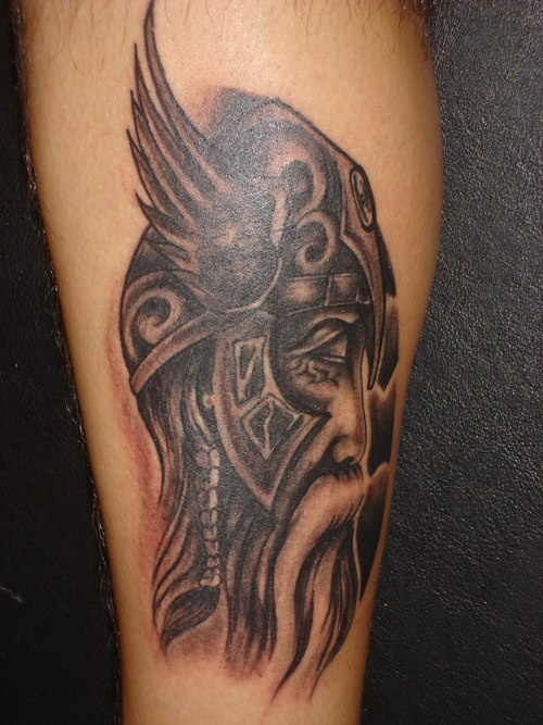 Nice Head In Grey Winged Helmet Tattoo For Boys