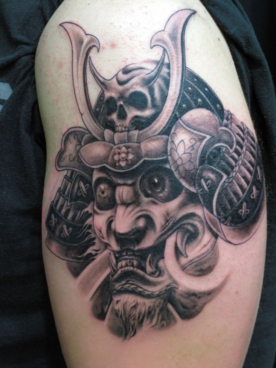 Passionate Head In Helmet Tattoo On Biceps For Boys