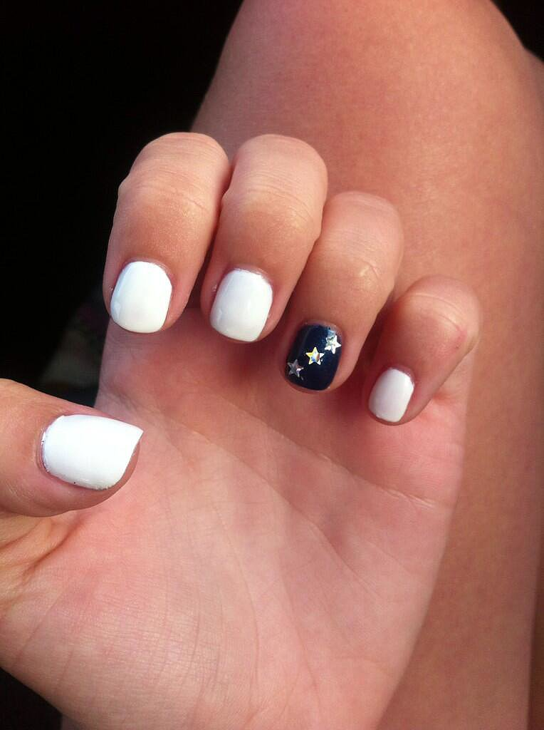 Proper White With Stars Accent Nail Design