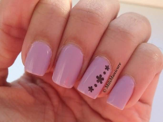 Simple Pink Paint With Black Flower Accent Nail Art