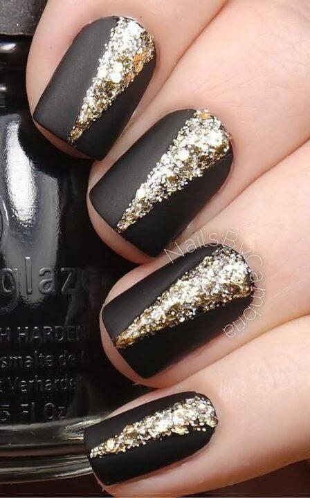 Sparkling Black Matte Nails With Golden Shaped Design