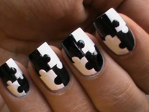 Stunning Black Nail Art With Puzzle Design