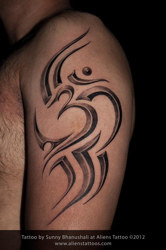 Stunning Tribal Om Tattoo On Biceps For Boys