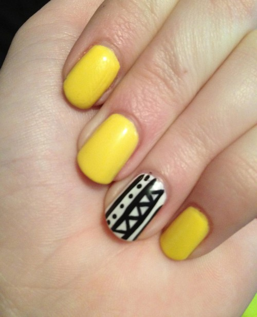 Stunning Yellow Color With Black And White Nails