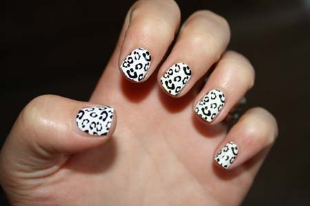 Stylish White And Black Nail Art With Leopard Print