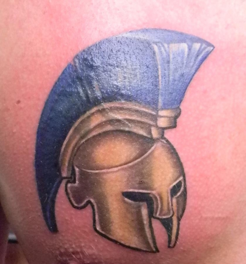 Terrific Golden Helmet With Blue Hairs Tattoo On Chest For Boys