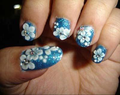 Tremendous Light Blue Nails With Flower Design