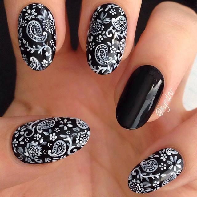 Tremendous White Designs on Black Acrylic Nail Art