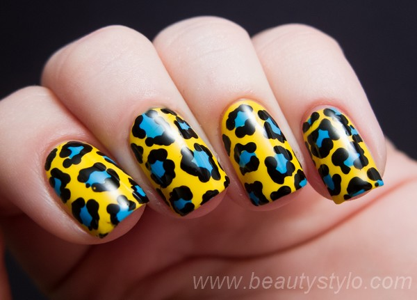 Tremendous Yellow And Blue Nails With Leopard Nails