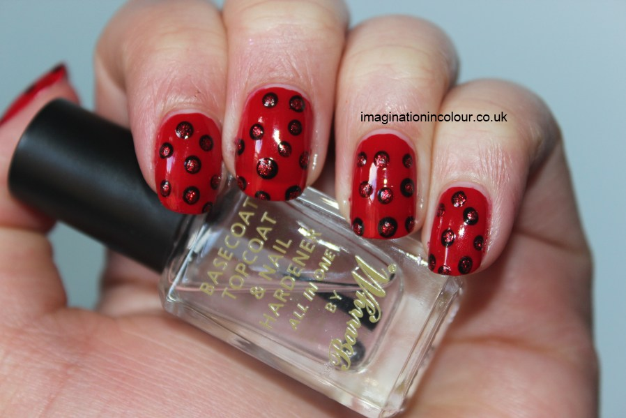 Tremendous Red And Black Nails With Round Silver Color Design