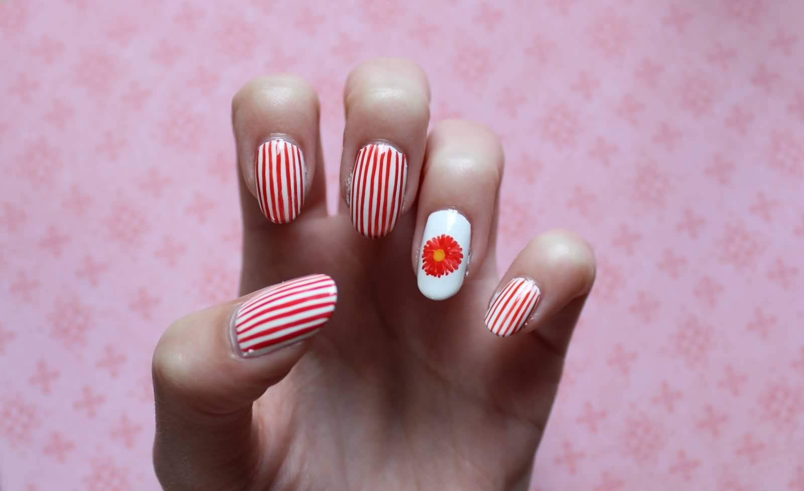 Ultimate Red And White Stripes With Flower Accent Nail Art