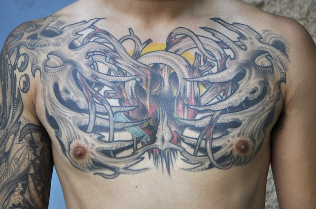Weird Biomechanical Heart & Skeleton Tattoo On Chest For Boys