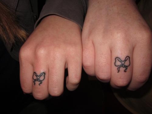 Weird Bow Finger Tattoo Design For Girls