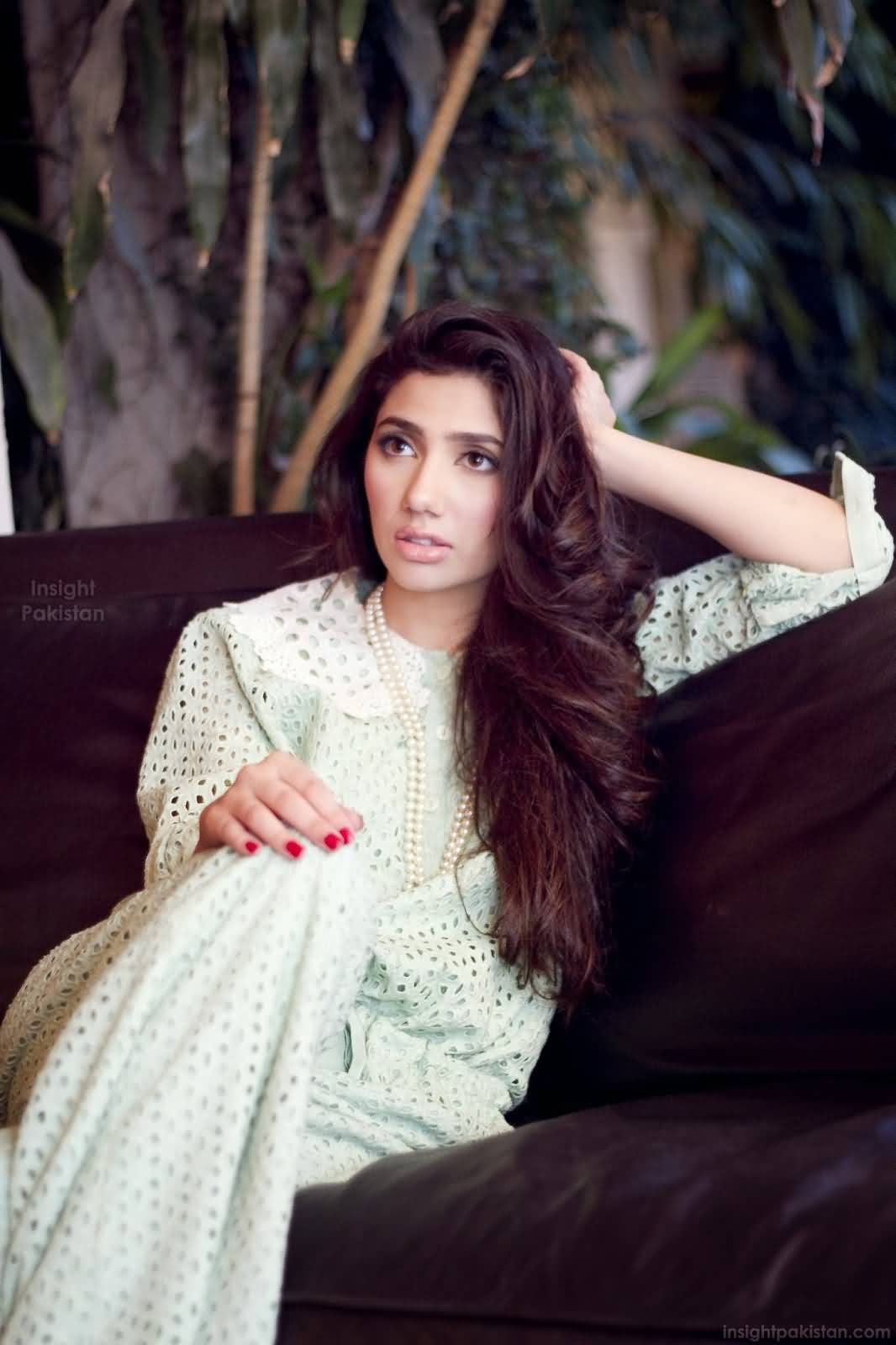 mind blowing mahira khan sitting on sofa