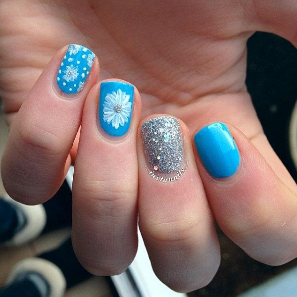Glittery Blue And Silver Nails With Flower