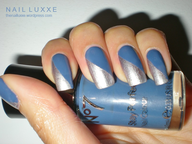 Stunning Blue And Silver Nails With Diagonal Design