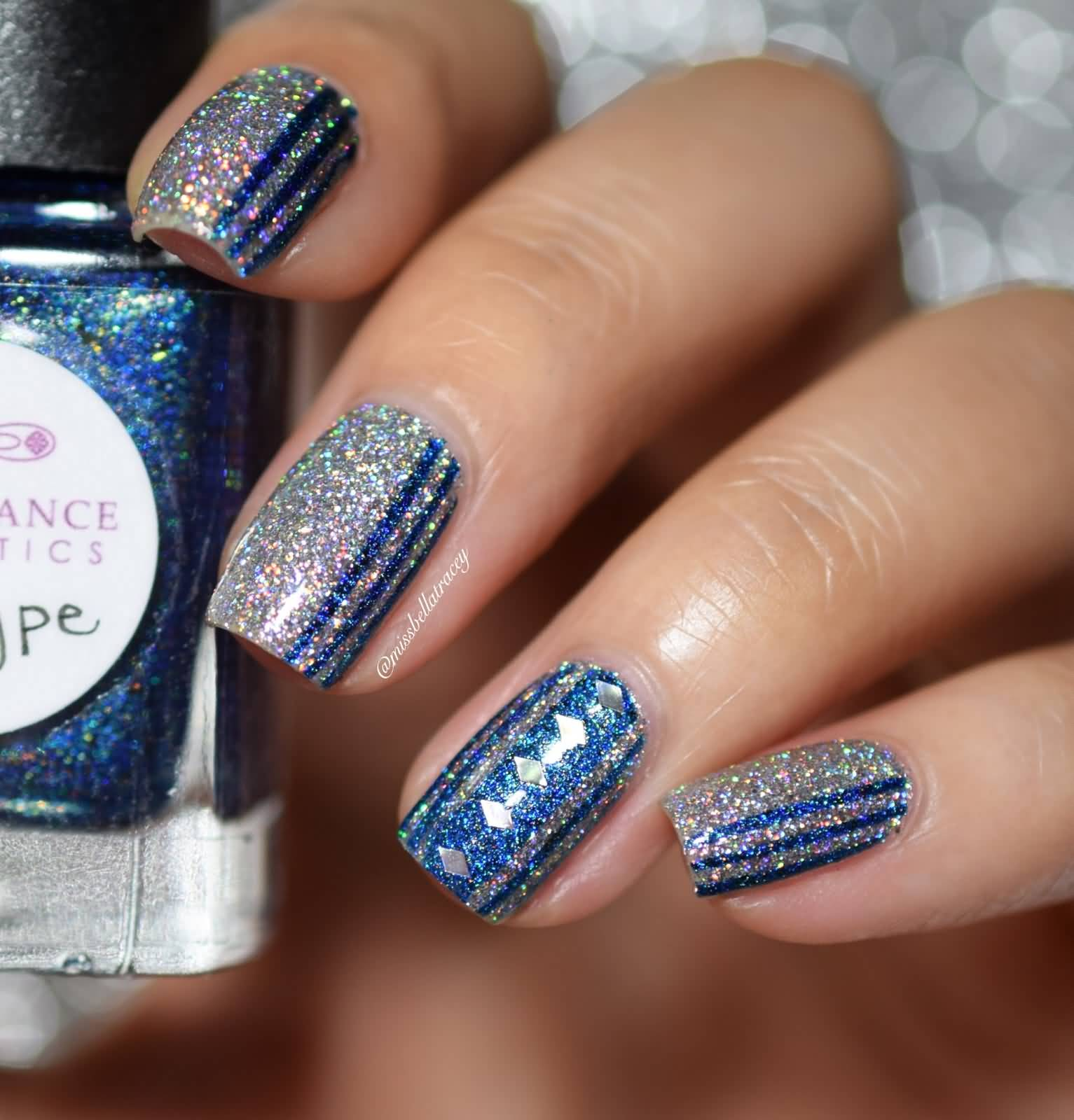 Wonderful Blue And Silver Nails With Lining Design