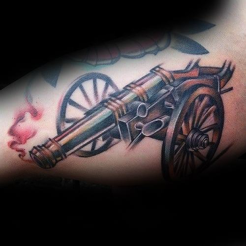 Famous Cannon Tattoo On Arm For Boys only