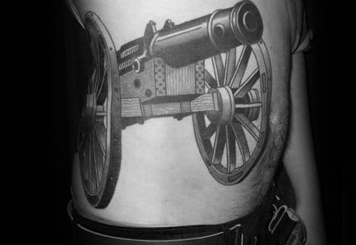 Horrible Cannon Tattoo On Rib side For Boys