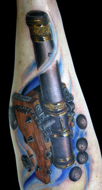 Superb Cannon Tattoo On Arm For Girls