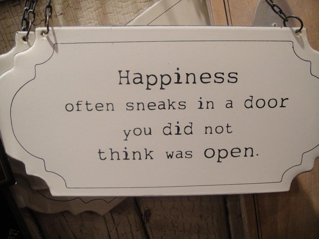 Motivational Love Quotes happiness often sneaks in a door
